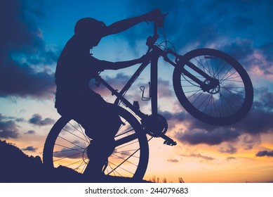 silhouette  Bicycle in sunset (retro and vintage style) and show power
