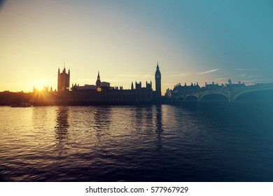 Silhouette of Big Ben and Houses of Parliament, London, UK against orange sunset ü retro styled photo
