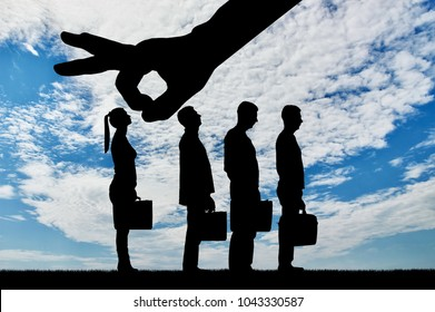 Silhouette of a big hand employer prefers male employees instead of women. The concept of gender inequality and discrimination in a career for women