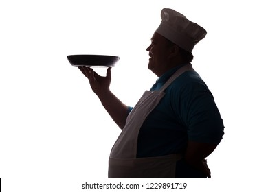 silhouette of a big-bellied happy chef carrying a dish in pan on his hand on a white isolated background, good-natured man's profile in a chef's hat and apron, concept of success in food industry
