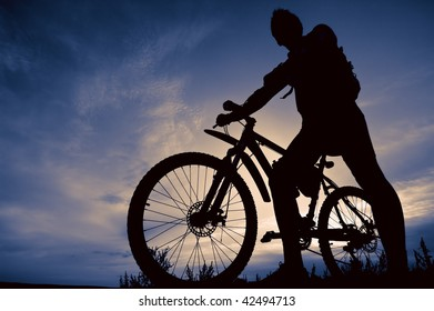 silhouette of biker at sunset