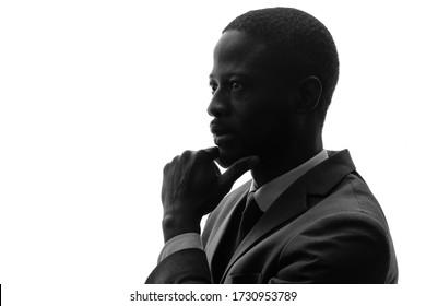 Silhouette of black businessman thinking something.