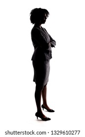 Silhouette of a black businesswoman or an anonymous female presidential candidate.  The person is backlit and isolated on a white background.