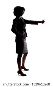 Silhouette of a Black Businesswoman gesturing approval by doing a thumbs up action