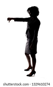Silhouette of a Black Businesswoman gesturing disapproval by doing a thumbs down.  She is isolated on a white background.