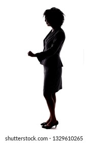 Silhouette of a Black Businesswoman gesturing happy by doing a cheerful action pose.  She is isolated on a white background