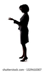 Silhouette of a Black Businesswoman gesturing like she is speaking or giving a speech like a teacher, presenter or a political candidate campaigning.