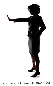 Silhouette of a Black Businesswoman gesturing stop by holding hands up.  She is isolated on a white background