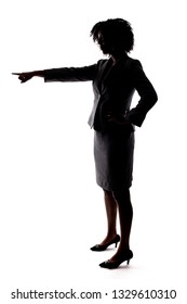Silhouette of a Black Businesswoman pointing forward and isolated on a white background