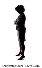 Silhouette of a Black Businesswoman posing sad by holding head low. She is isolated on a white background