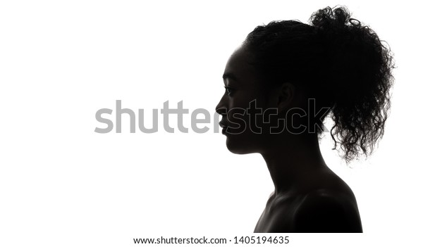 Silhouette of a black girl. Beauty concept.