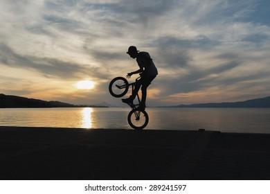 Silhouette of a bmx biker.
