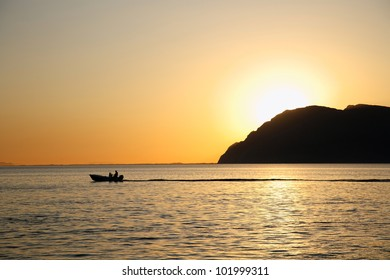 silhouette of a boat during the sunset