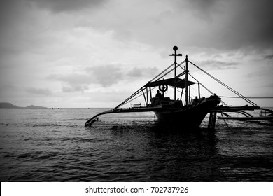 Silhouette of Boat in the Shores of the Philippines. Photo in Black and White with Vignette