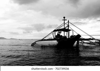 Silhouette of Boat in the Shores of the Philippines. Photo in Black and White