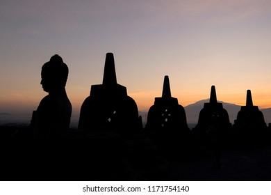 silhouette of the Borobudur temple at sunrise