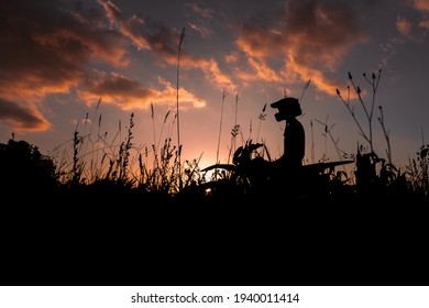 silhouette of a boy on top of his trail bike 2