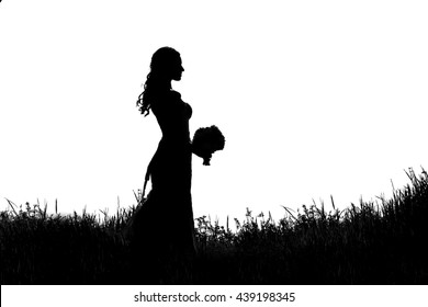 silhouette of bride with bouquet in the grass on a white background