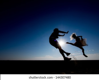 silhouette of bride jump kicking a guy, vignette added. Don't piss women off