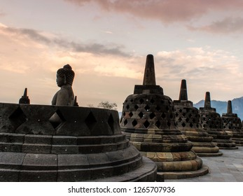 Silhouette of Buddha in the Borobudur Temple at sunset, Indonesia