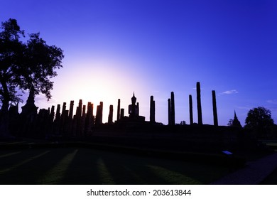 Silhouette Buddha Statue in Wat Mahathat Temple in Sukhothai Historical Park, Sukhothai Province, Thailand .