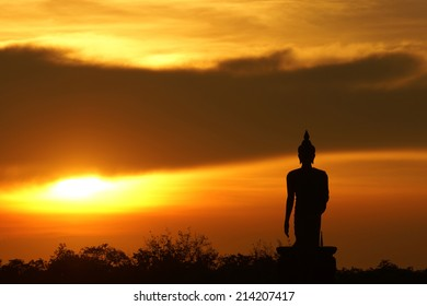 Silhouette Buddha and Sunset statue in Thailand