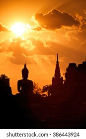 Silhouette of Buddha in a temple at Thailand evening.