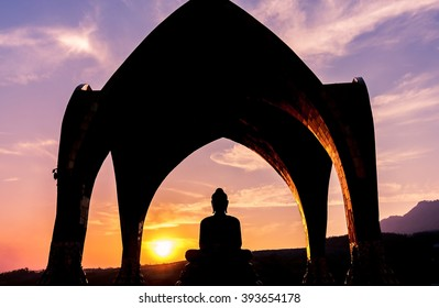 Silhouette of buddha at Wat Pha Sorn Kaew or Wat Phra Thart Pha Kaew, the public buddhist monastery and temple in Khao Kor in the dark evening during sunset with backlight, Thailand