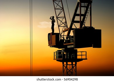 Silhouette of a builder on construction cranes