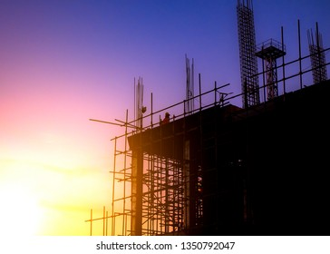Silhouette of the building structure in the construction industry and the beautiful sky during the sunset.-image