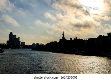 Silhouette of buildings at a canal in Amsterdam