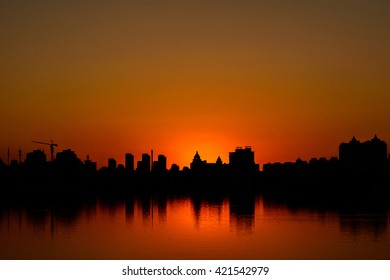 Silhouette of Buildings at sunset time in metro city. Conceptual and idea image.