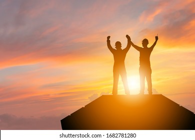 Silhouette of Business engineer man with clipping path celebration success happiness on container box evening sky sunset background, Teamwork Concept