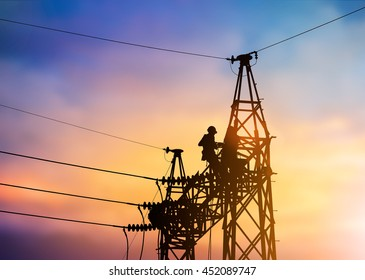 Silhouette Business Industrial Electrician for the installation of electrical systems for alternative energy over blurred pastel background sunset.Heavy industry and Transportation and People concept.