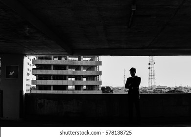 Silhouette of a Business Man arms crossed standing in New Property.black and white tone