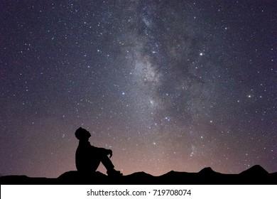 POEMAS SIDERALES ( Sol, Luna, Estrellas, Tierra, Naturaleza, Galaxias...) - Página 26 Silhouette-business-man-sitting-seeing-260nw-719708074