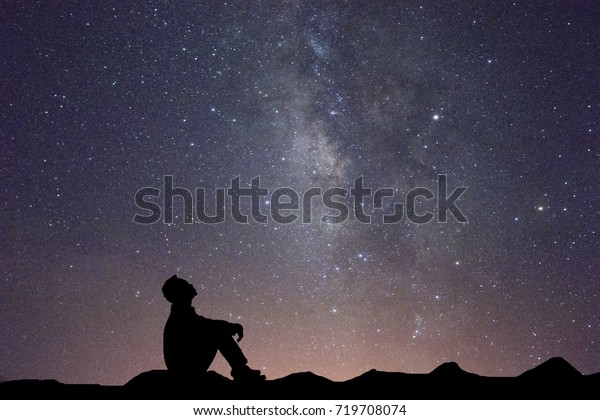 Silhouette business man sitting seeing milky way