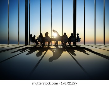 Silhouette of Business Meeting at Sunset