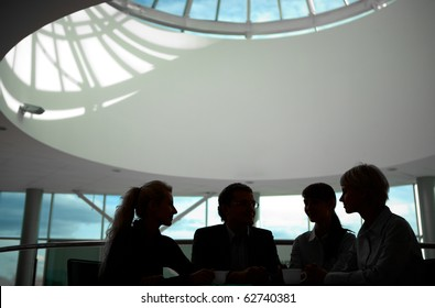 Silhouette of business people interacting with each other