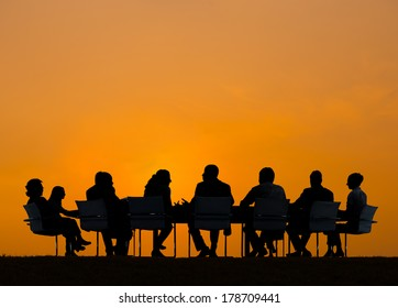 Silhouette of Business People Meeting at Sunset