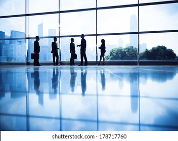 Silhouette of Business People Standing by Water