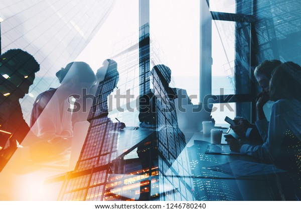 Silhouette of business people work together in office. Concept of teamwork and partnership. double exposure with light effects