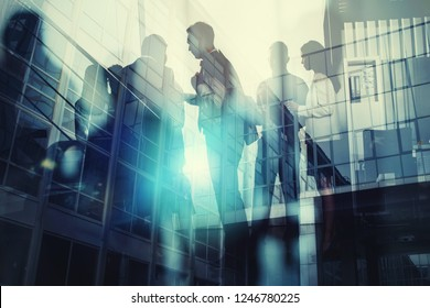 Silhouette of business people working together in office. Concept of teamwork and partnership. double exposure with light effects