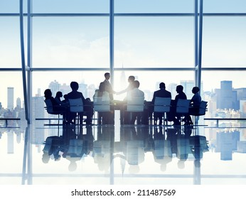Silhouette of Business Person in a Board Room