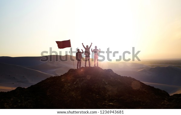 Silhouette of the Business team on top of a mountain . Business Success and Leadership concept.