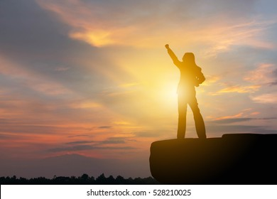 Silhouette of Business woman Celebration Success Happiness Sunset Evening Sky Background
