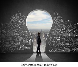 Silhouette of businessman against black wall. Idea concept