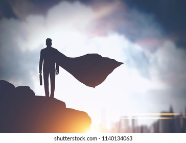 Silhouette of a businessman in a cape standing on a rock and looking at a modern cityscape. Toned image double exposure mock up