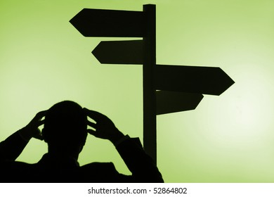 A silhouette of a businessman, confused about which direction to go.