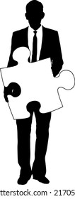 A silhouette of a businessman holding a piece of jigsaw ready for you to add your own text